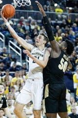 Franz Wagner makes a layup against Purdue forward Trevion Williams during the second half.