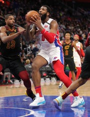 Andre Drummond drives against Cavs center Tristan Thompson during the second period Thursday.