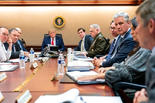 In this image released by the White House, President Donald Trump, joined by Vice President Mike Pence, meets with senior White House advisors Tuesday evening, Jan. 7, 2020, in the Situation Room of the White House in Washington.
