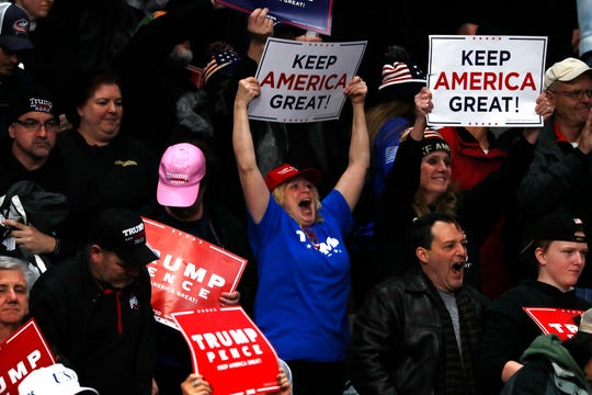 Supporters cheer as President Donald Trump speaks at a campaign rally, Thursday, Jan. 9, 2020, in Toledo, Ohio.