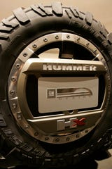 GM plans to bring back the Hummer nameplate under the GMC brand.