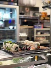 A few sushi rolls get ready to be sliced on the counter at the newly renovated Noble Fish cafe and market in Clawson.