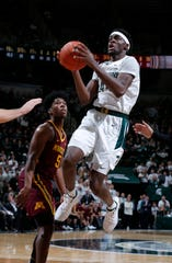 Michigan State's Gabe Brown goes to the basket past Minnesota's Marcus Carr on Thursday night.