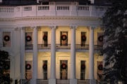 A view of the south side of the White House in Washington decorated for Christmas.
