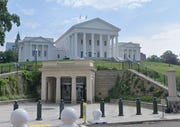 Virginia lawmakers voted Friday to ban firearms at the state Capitol.