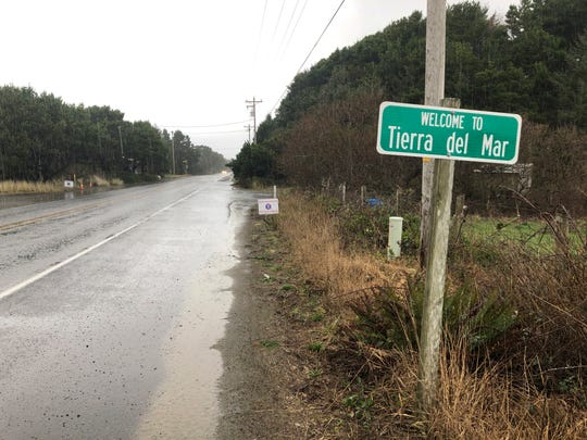 A sign welcomes motorists to Tierra del Mar, Ore., Wednesday, Jan. 8, 2020. The tiny coastal village is opposing a plan by Facebook to build a landing spot for a submarine cable connecting America with Asia.
