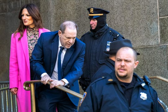 Harvey Weinstein, center, leaves Manhattan criminal court with his lead attorney Donna Rotunno, left, after jury selection during his sexual assault trial, Thursday, Jan. 9, 2020, in New York.