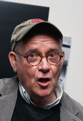 """FILE - In this Nov. 28, 2006, file photo, actor Buck Henry arrives to the private screening of the """"Children of Men"""" at the Museum of Modern Art in New York."""