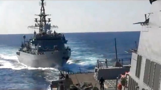 This photo provided by the U.S. 5th Fleet, shows a Russian Navy ship approaching an American warship in the North Arabian Sea, on Thursday, Jan. 9, 2020.  A spokesman for U.S. 5th Fleet said Friday that the USS Farragut was conducting routine operations Thursday and sounded five short blasts to warn the Russian ship of a possible collision. He said the USS Farragut asked the Russian ship to change course and the ship initially refused but ultimately moved away.