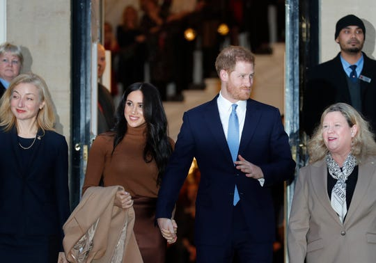 Britain's Prince Harry and Meghan, Duchess of Sussex leave after visiting Canada House in London Tuesday, after their recent stay in Canada.