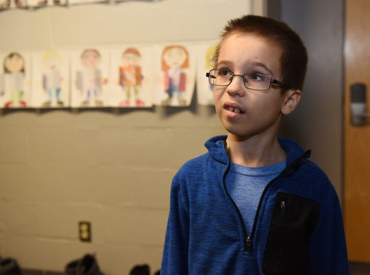 Walled Lake's Mary Guest Elementary School second grader Dylan Viola, 8, talks about how Champ made him feel better after a incident at school.