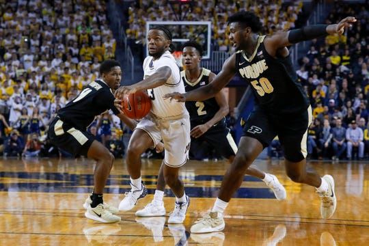 Michigan guard Zavier Simpson drives next to Purdue forward Trevion Williams during the second half.