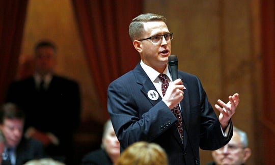 In this Feb. 8, 2012 file photo, state Rep. Matt Shea, R-Spokane Valley, speaks at the Capitol in Olympia, Wash. Shea faces a legislative investigation and calls for his resignation following media reports he was in a chat group discussing surveillance on progressives.