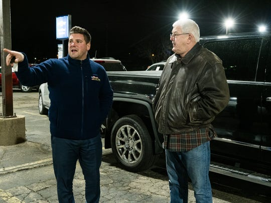 Matthews-Hargreaves Chevrolet salesman Domenic Maiani goes over the features of a certified pre-owned truck with potential customer Frank Ceravolo of Warren at the Royal Oak dealership on January 9, 2020.Ceravolo and with wife Barbara are looking to purchase a newer truck.