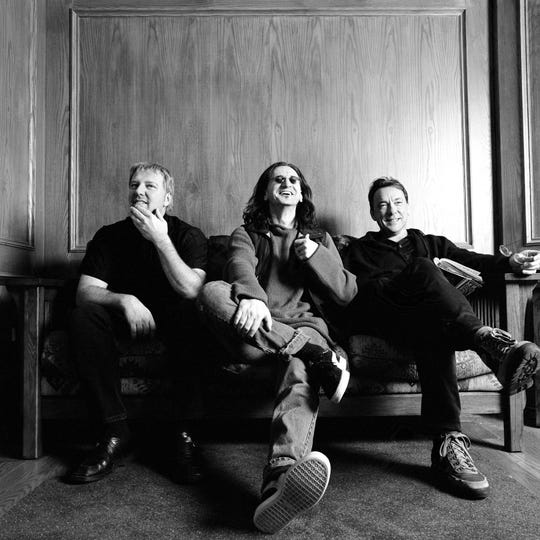 Rush members, from left to right, Alex Lifeson, Neil Peart and Geddy Lee. Peart died on Tuesday at the age of 67.