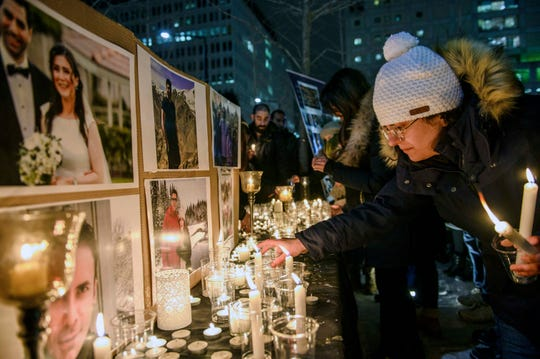 Members of Montreal's Iranian community attend a vigil, Thursday, Jan. 9, 2019 in downtown Montreal for those aboard a civilian Ukrainian jetliner that crashed near Tehran late Tuesday, killing all 176 people on board.
