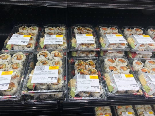Pre-made sushi rolls can be purchased and eaten in the cafe at the newly renovated Noble Fish market in Clawson.