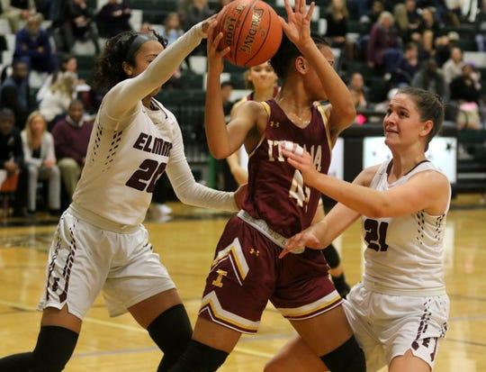 Elmira's Zaria DeMember-Shazer (left) and Morgan Gentile defend Ithaca's Ava Thomas during the Express' 69-37 win in girls basketball Jan. 9, 2020 at Elmira High School.