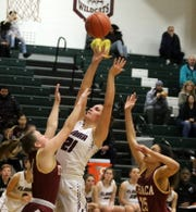 Morgan Gentile of Elmira goes up for a shot as Ithaca's Skylar Orlowski (left) and Kianna Eddy (25) defend during the Express' 69-37 win in girls basketball Jan. 9, 2020 at Elmira High School.