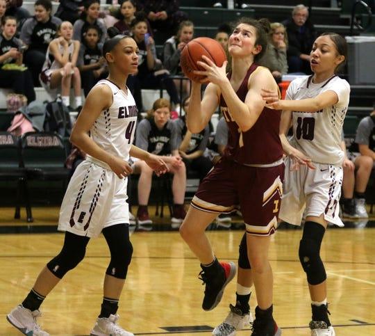 Ithaca's Georgia Haverlock puts up a shot in between Elmira's Kiara Fisher (4) and Jalea Abrams (10) during the Express' 69-37 win in girls basketball Jan. 9, 2020 at Elmira High School.