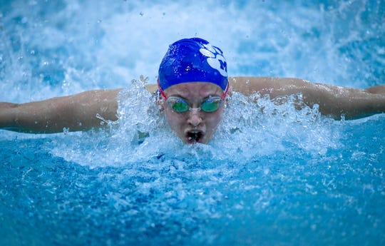 Memorial senior Elizabeth Broshears, in the lead, as she competes in the Girls 100 Yard butterfly during a swim meet held at Mount Vernon High School Thursday, January 10, 2020.