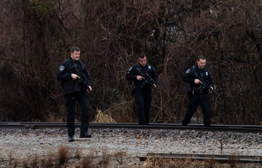 Evansville police return to their vehicles after giving chase to Jacob Wesley Bengert – a man wanted in the killing of his 3-month-old son – on a set of railroad tracks south of Maxwell Avenue Friday afternoon, Jan. 10, 2020. Bengert was captured after being on the run from authorities since Thursday morning.