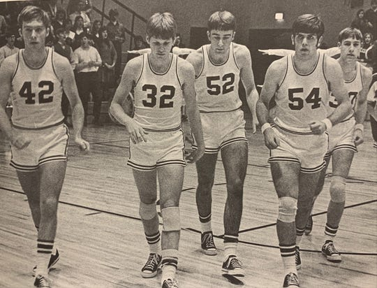 Mike Flowers (42), Len Jacobs (32), Mike Keating (52), Jack Lintzenich (54) and Bill Theby take the floor for Memorial's first game in its new gym on Jan. 13, 1970.