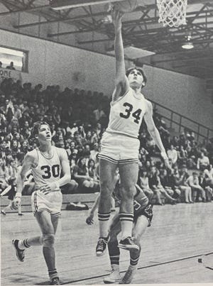 Dave Mattingly goes up for a layup in the Tigers' 90-64 victory over Boonville on Jan. 13, 1970, the first game played in Memorial's current gym. Bill Theby (30) is in the background.