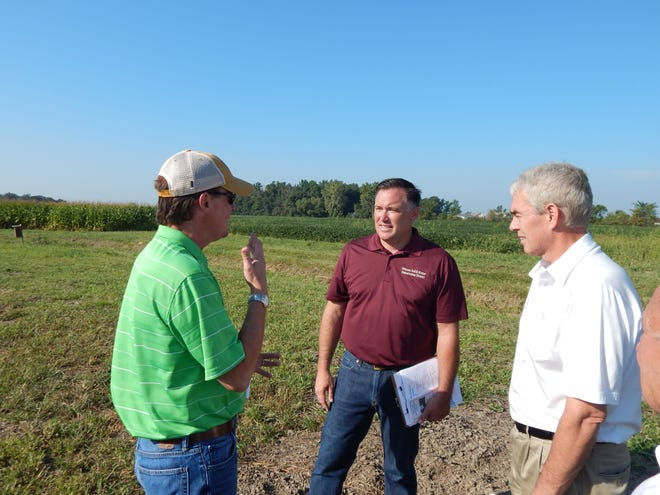 Mike Libben, center, Ottawa Soil and Water Conservation District  administrator, discusses conservation practices with former state Rep. Chris Redfern, left, and former state Sen. Randy Gardner at Libben's farm near Oak Harbor in 2015. Libben is scheduled to speak Thursday about H2Ohio at the Lake Erie Waterkeeper's monthly meeting in Toledo.