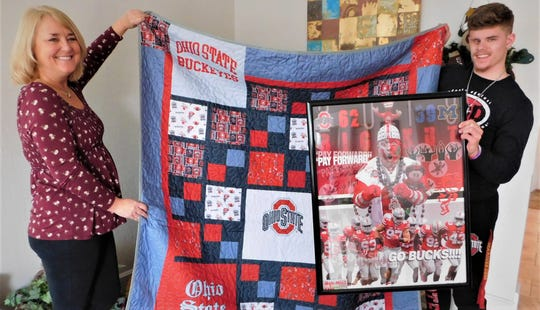 Bev Henson and Chase Berger hold a special Ohio State University quilt and Big Nut poster that will be auctioned off at the Chase Berger Childhood Cancer Survivor Benefit on Jan. 18 at the Clyde VFW.