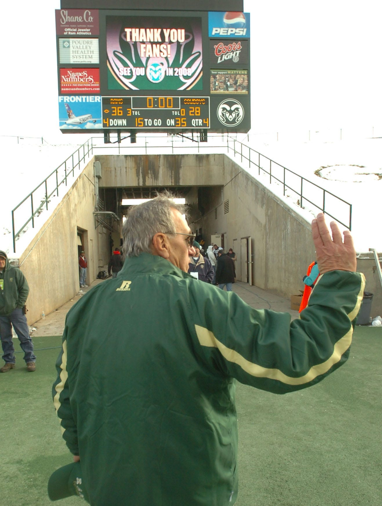 Sonny Lubick waves to fans as he leaves the field after a win against Wyoming in 2007. Three days later, CSU announced his firing.
