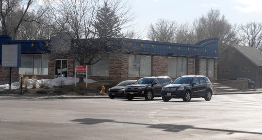 Various buildings currently occupy the three underdeveloped parcels where Alpine Bank has proposed a new two-story bank on the southeast corner of Prospect Road and College Avenue in Fort Collins, Colo. on Friday, Jan. 10, 2020.