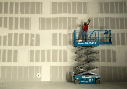 Workers were busy on the drywall at D-Bat, a national franchise for batting cages, on Friday, Jan 10, 2020, in south Fort Myers.