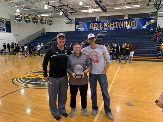 Bishop Verot coach Matt Herting (left), Greg Coleman (center) and ECS head coach Scott Guttery (right) pose for a picture following Lehigh's 69-36 win over Estero. Coleman notched his 200th victory against the Wildcats.