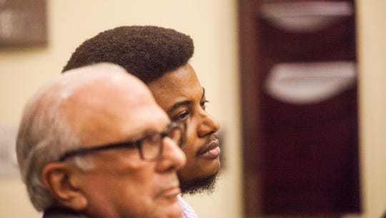 Jeovanni Hechavarria, 37, a former nurse, sits in a courtroom during his rape trial at the Lee County courthouse on Friday, Jan. 10, 2020. He is represented by Allen Kaufman.