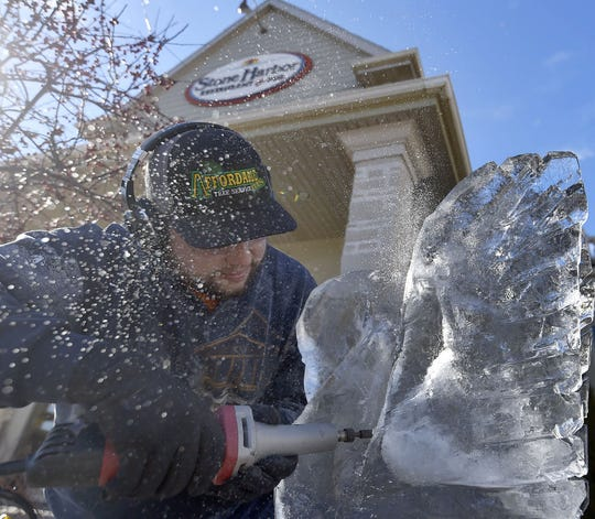 Cody Leist of Jacksonport carves a block of ice into a piece of art at Stone Harbor Resort & Conference Center as part of a past Fire & Ice festival in Sturgeon Bay.