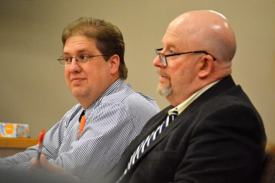 Tyler Readman of Pound, left, listens as his attorney, Rick Meier, questions as witness on Jan. 8 during Readman's trial on sexual assault charges in Oconto County Circuit Court.