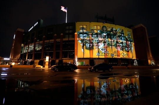 An image of Green Bay Packers playersis projected on the west side of Lambeau Field on Thursday ahead of the team's home playoff against the Seattle Seahawks in Green Bay.