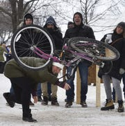 Jen Ostapowich of Oconomowoc lets it fly while competing in the bicycle toss at a past Fish Creek Winter Festival.