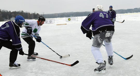 Teams battle on a frozen-over Kangaroo Lake in a past Door County Pond Hockey Tournament in Baileys Harbor.