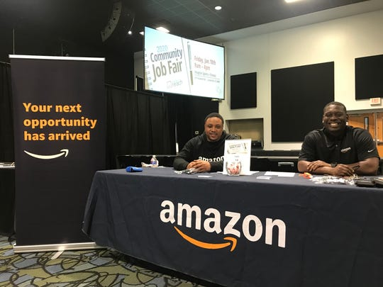Jarrick Surratt and Dimario Evans, staffing coordinators for Amazon, recruit employees at the first community job fair held at Relentless Church on Friday, Jan. 10, 2019