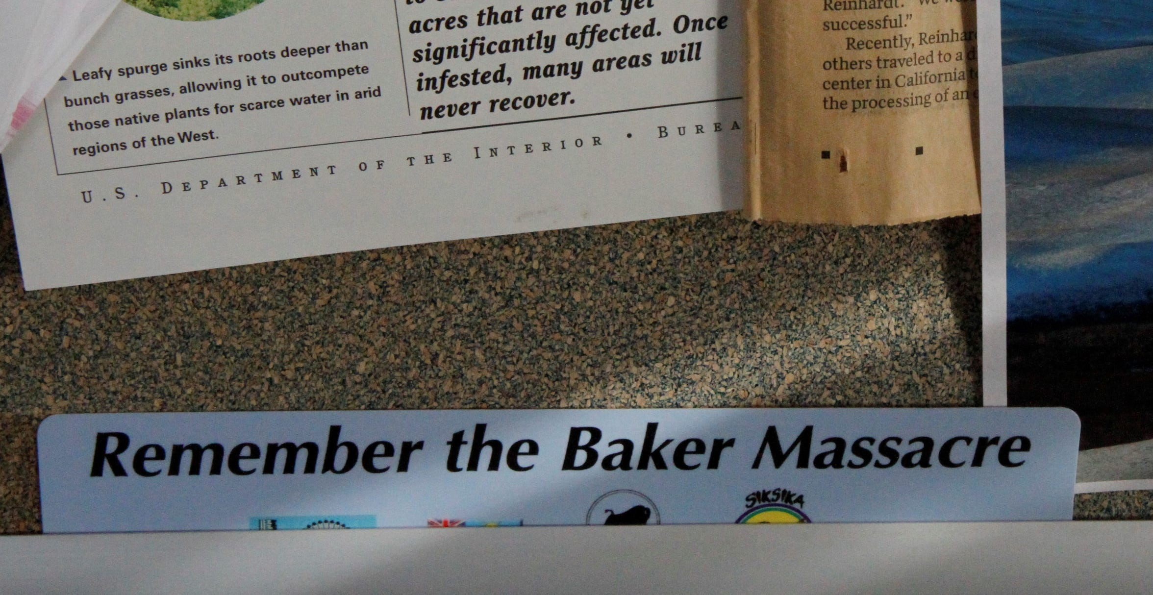 """A """"Remember the Baker Massacre"""" bookmark is on display in Tribal Historic Preservation Officer John Murray's office."""