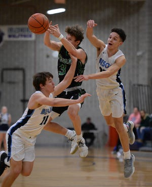 Great Falls High's Gabe Longin, left, and Tarel Rollins attempt steal the ball from Belgrade's Tate Bowler in Thursday's basketball game.