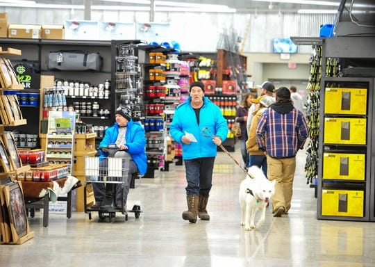 Jim and Linda Hoover shop with their dog Silver at the new North 40 Outfitters store on the west side of Great Falls.