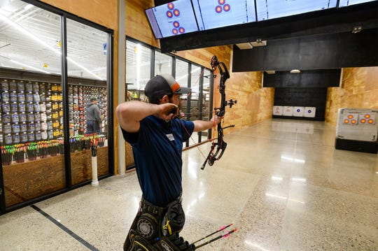 Connor Olson, an archery tech at the new North 40 store on the west side of Great Falls, uses the archery range on store's opening day, Thursday, January 9.