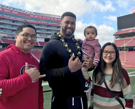 Kaimana Terlaje, left, and his family meet DeForest Buckner, defensive tackle for the San Francisco 49ers, who's holding Mateo Terlaje, and Maria Terlaje.
