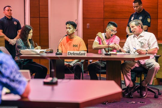 Defendant Emmanuel Reselap, in pink shirt, shakes the hands of his legal counsel, Sam Teker, as he appears in court with his brother and co-defendant, Jordan Rachulap, in orange, and Rechulap's attorney, Gloria Rudolph, during their scheduled sentencing hearing before Superior Court of Guam Judge Vernon Perez at the Guam Judicial Center in Hagåtña on Friday, Jan. 10, 2020.