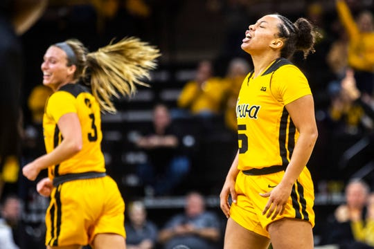 Iowa guard Alexis Sevillian (5) reacts after making a 3-point basket during a NCAA college Big Ten Conference women's basketball game, Thursday, Jan. 9, 2020, at Carver-Hawkeye Arena in Iowa City, Iowa.