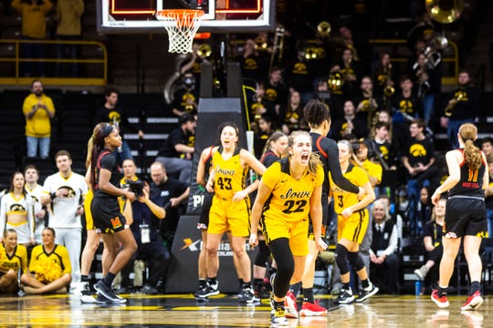 Team wins are more important than individual honors to Kathleen Doyle. Here, she (No. 22) celebrates the Hawkeyes' Jan. 9 win against Maryland.