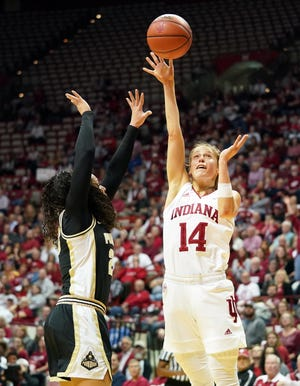 IU's Ali Patberg (14) shoots over Purdue  guard Kayana Traylor (23) on Jan. 9, 2020.